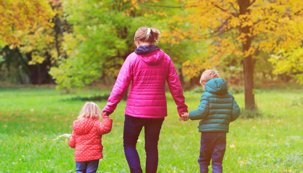 Mother walking with 2 children
